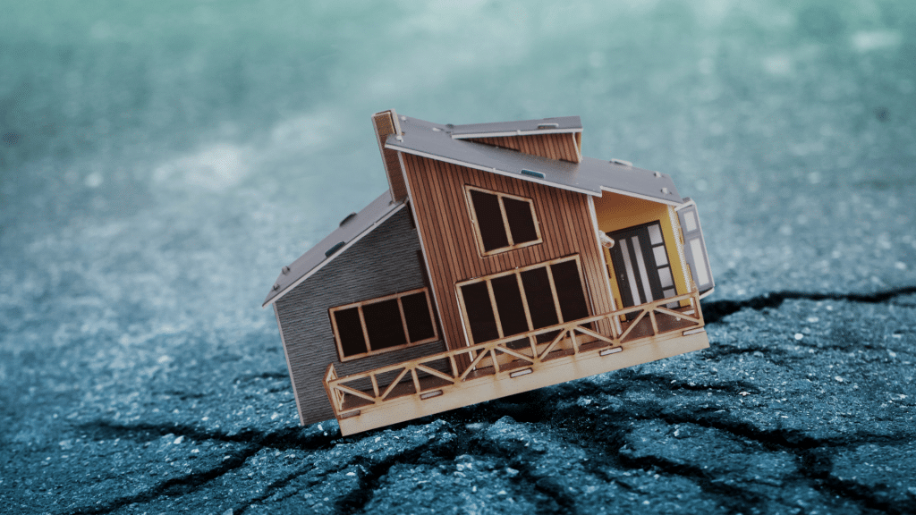House on the ground cracking under pressure