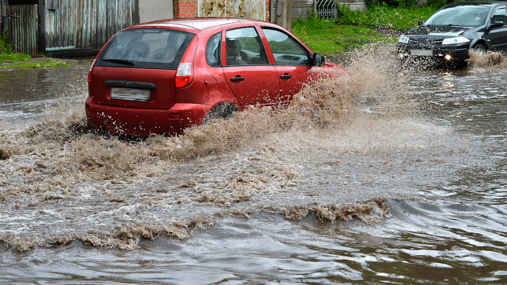 car passing through a flooded street