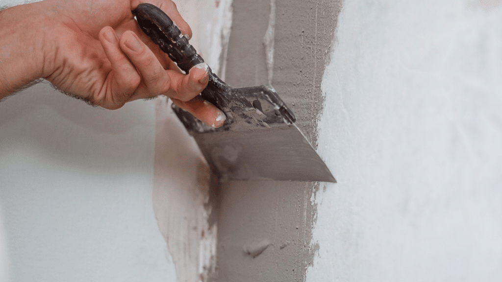 contractor plastering the wall