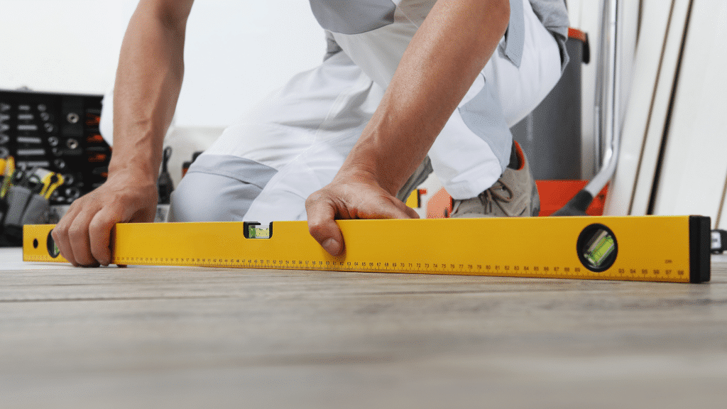 contractor using a spirit level