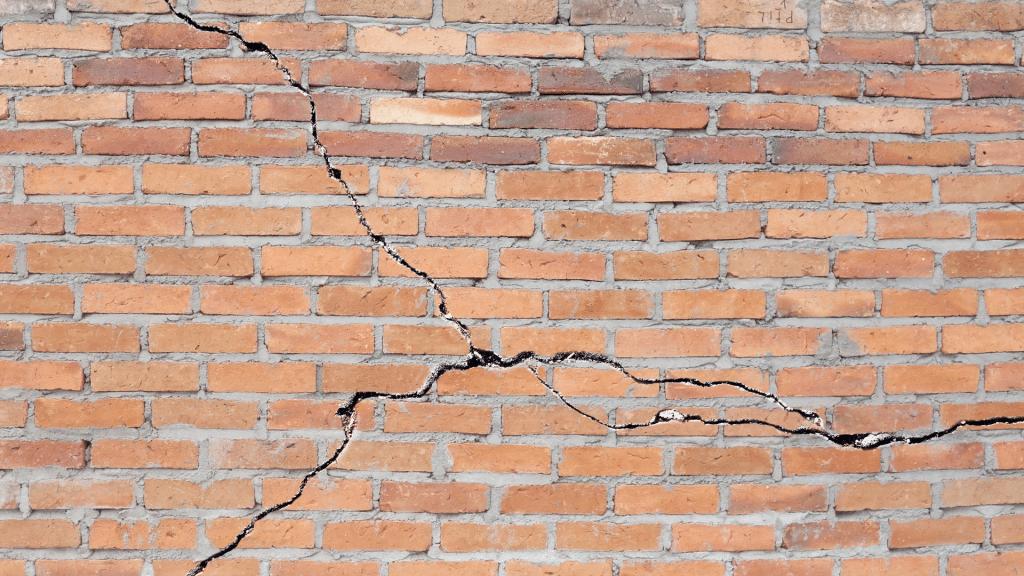 cracks on the brick facade