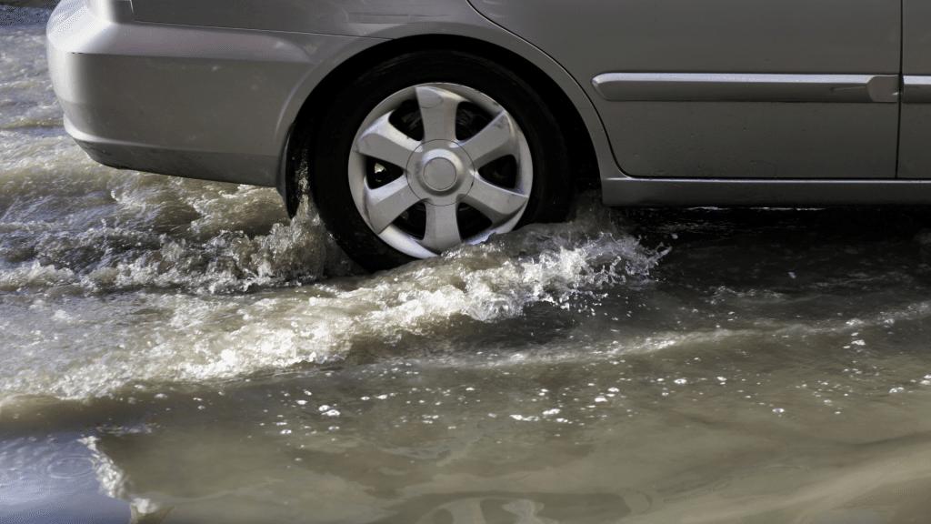 gray car passing through a flooded street