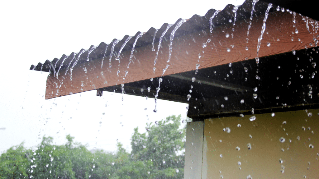 heavy rain falling from the roof