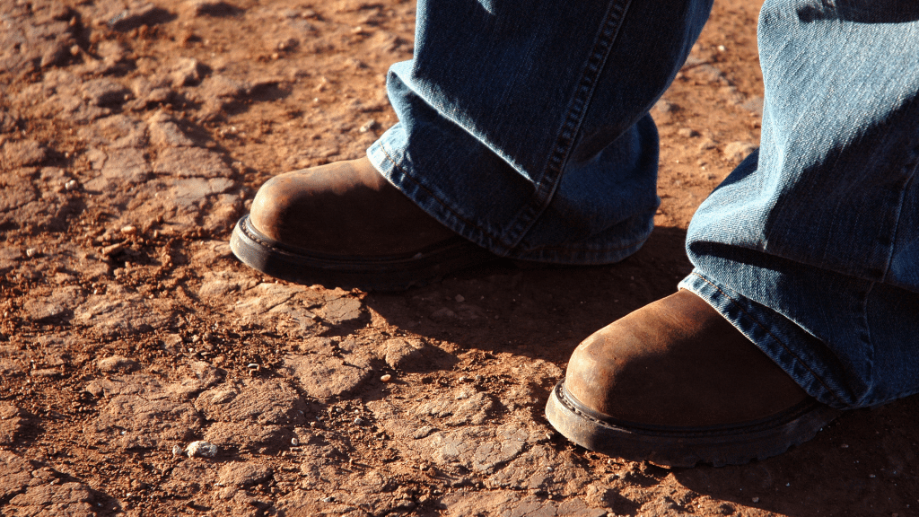 man standing on the soil