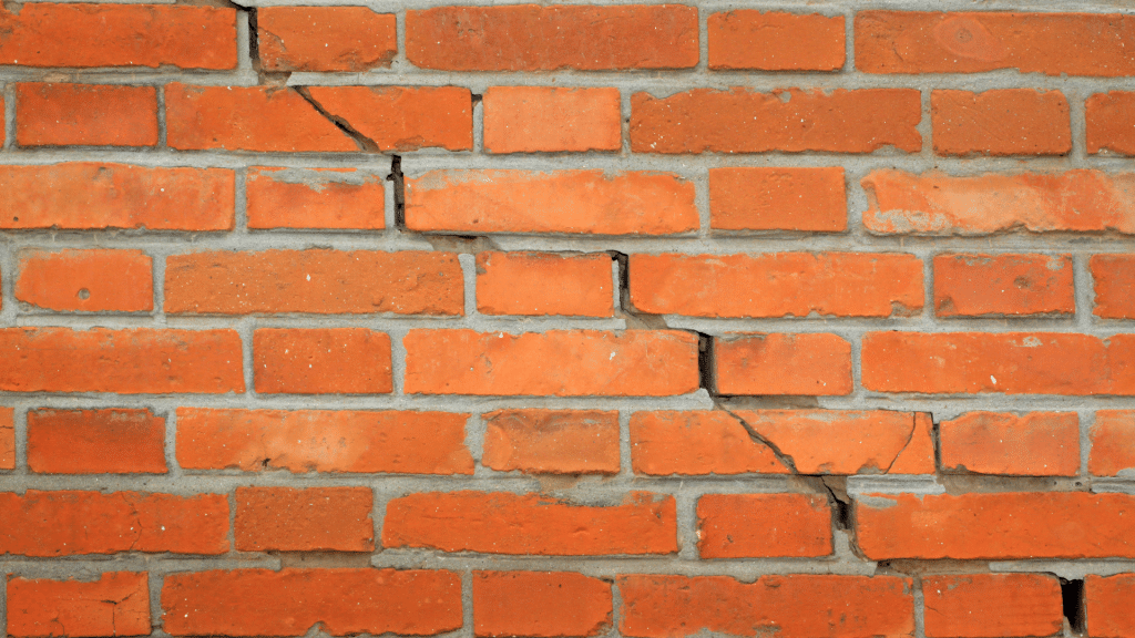 stair step cracks on the brick wall
