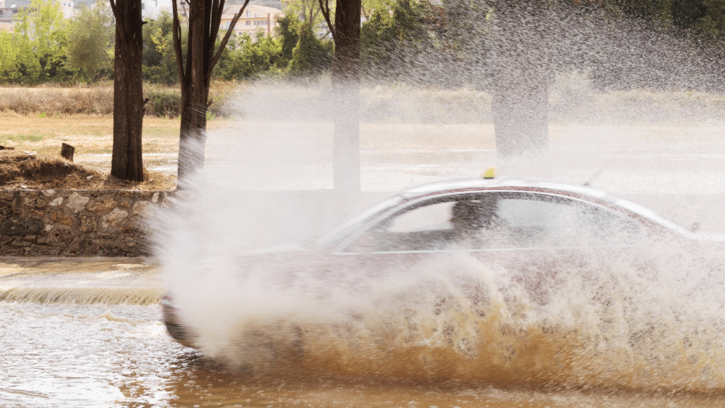 the car passes through a flooded street