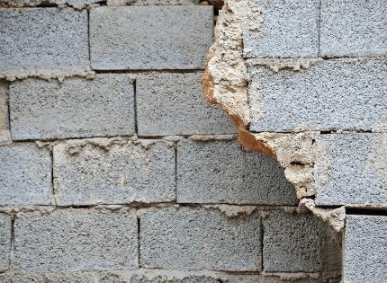 sealant applied to exterior foundation cracks